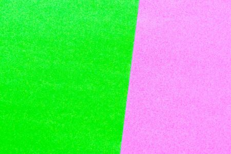 Abstract green and pink color paper textured background with copy space for design and decoration