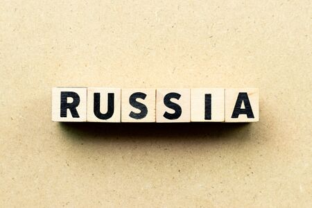 Letter block in word russia on wood background