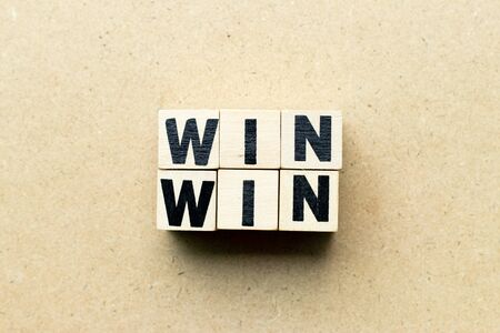 Letter block in word win win on wood background (Concept of game theory)
