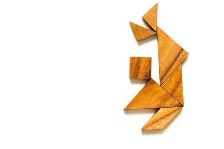 Wood tangram puzzle in dancing man shape on white background (Concept for happiness, joy)