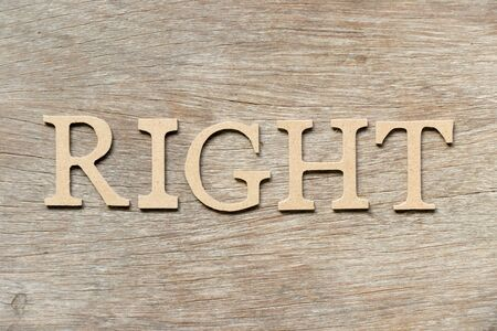 Alphabet letter in word right on wood background