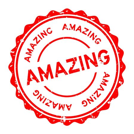 Grunge red amazing word round rubber seal stamp on white background