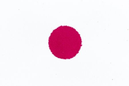 Red ink dot splashed on white paper background