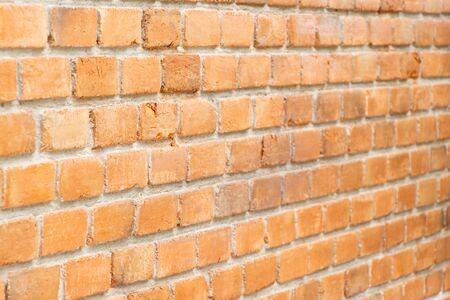 Grunge old red brick pattern textured background. (Focus at front)