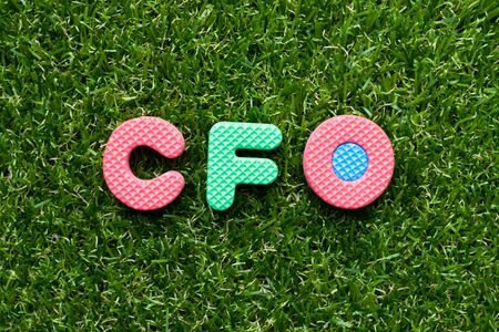 Toy foam letter in word CFO (Abbreviation of Chief Financial Officer) on green grass background