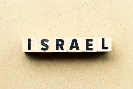 Letter block in word israel on wood background