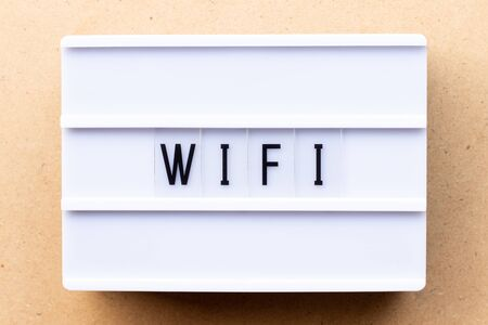 Lightbox with word wifi on wood background Stok Fotoğraf