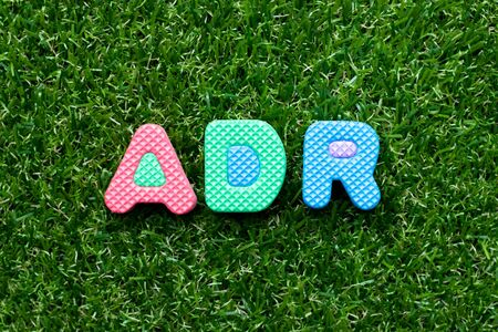 Toy foam letter in word ADR (Abbreviation of Adverse drug reaction) on green grass background