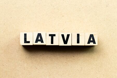 Letter block in word latvia on wood background