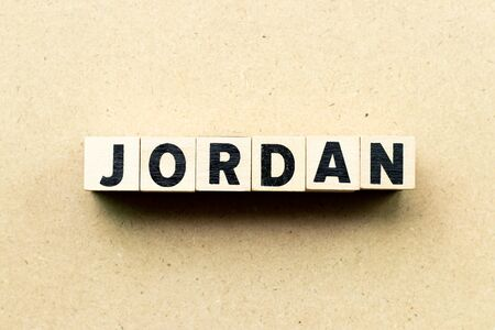 Letter block in word jordan on wood background