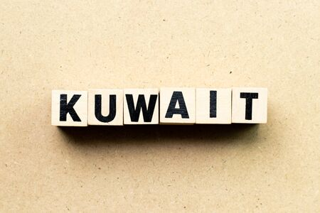 Letter block in word kuwait on wood background Stock Photo