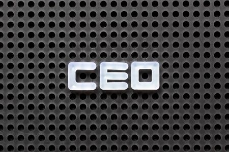 Black color pegboard with white letter in word CEO (abbreviation of Chief Executive Officer) Archivio Fotografico - 128703463