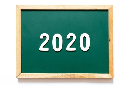Green blackboard and wood frame with word 2020 on white background Archivio Fotografico - 128703475