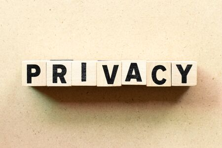 Letter block in word privacy on wood background