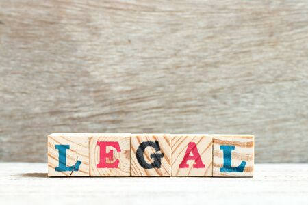 Letter block in word legal on wood background