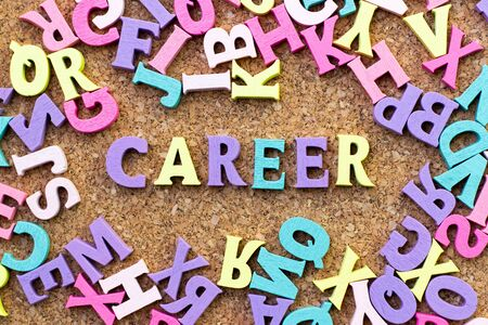 Color alphabet in word career with another letter as frame on cork board background Banco de Imagens