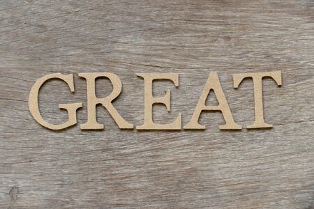 Alphabet letter in word great on wood background