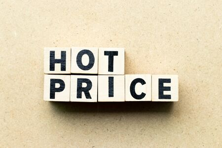 Letter block in word hot price on wood background Banco de Imagens