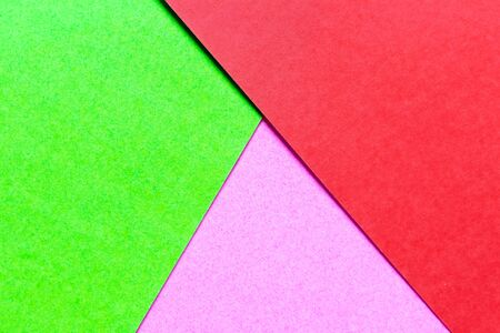Abstract green, pink and red color paper textured background with copy space for design and decoration Banco de Imagens