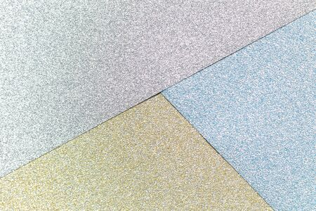Gold, silver, blue color glitter paper textured background