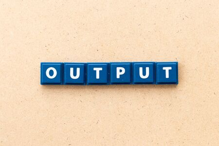 Tile letter in word output on wood background