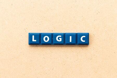 Tile letter in word logic on wood background