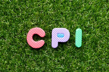 Toy foam letter in word CPI (abbreviation of Consumer Price Index) on green grass background Stok Fotoğraf - 129761628
