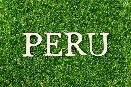 Wood letter in word Peru on green grass background 版權商用圖片