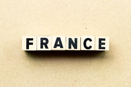 Letter block in word France on wood background