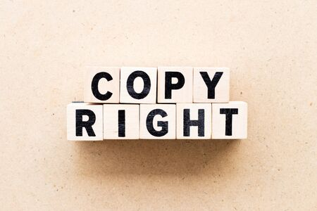 Letter block in word copyright on wood background 版權商用圖片