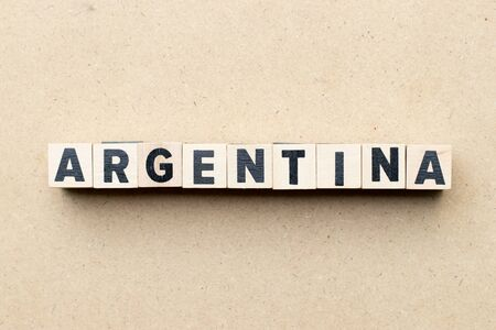 Letter block in word Argentina on wood background