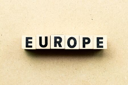 Letter block in word Europe on wood background