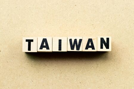 Letter block in word Taiwan on wood background
