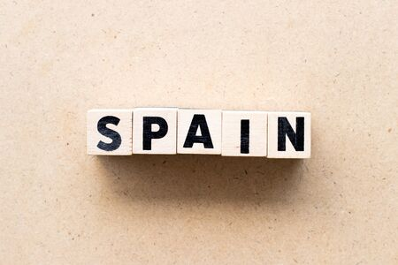 Letter block in word spain on wood background