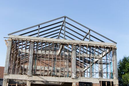 Structure of house wait for complete builidng with blue sky background