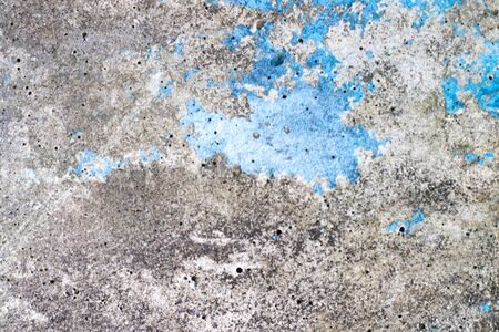 Concrete textured background with crack of blue color painting