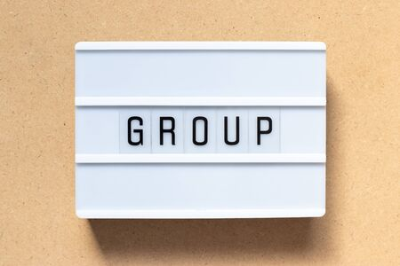 White lightbox with word group on wood background