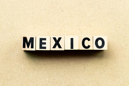 Letter block in word Mexico on wood background