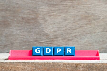 Tile letter on red rack in word GDPR (General Data Protection Regulation) on wood background Archivio Fotografico - 130135826
