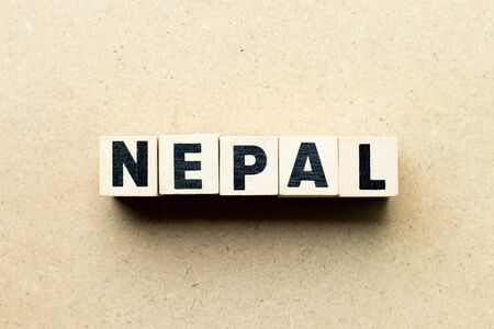 Letter block in word Nepal on wood background Фото со стока