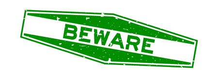 Grunge green beware word hexagon rubber seal stamp on white background Фото со стока - 130519437