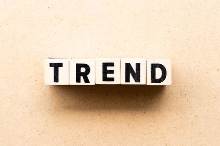 Letter block in word trend on wood background