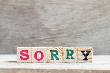 Letter block in word sorry on wood background 스톡 콘텐츠