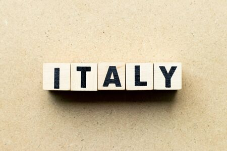 Letter block in word italy on wood background