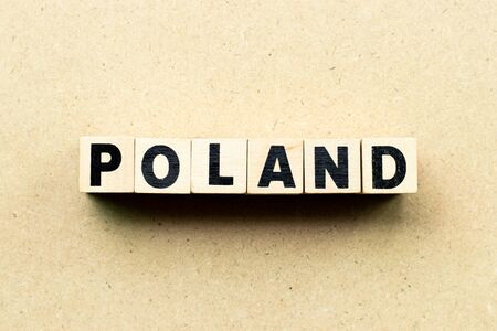Letter block in word Poland on wood background Stock Photo