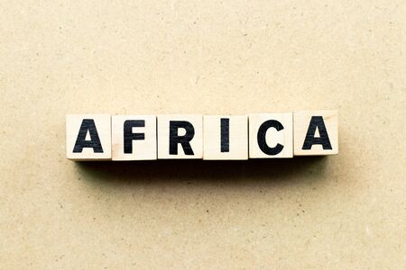 Letter block in word Africa on wood background