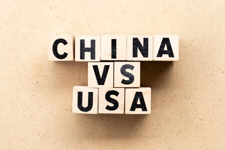 Letter block in word china vs usa on wood background
