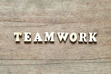 Letter block in word teamwork on wood background