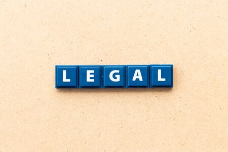 Tile letter in word legal on wood background