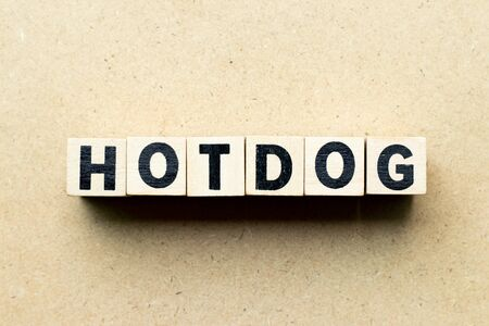 Letter block in word hotdog on wood background